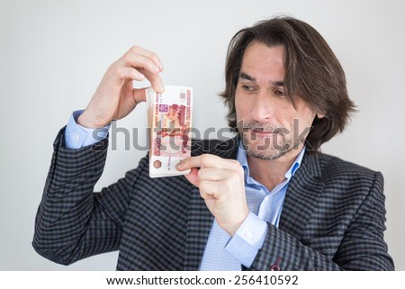 man with Russian money in his hands