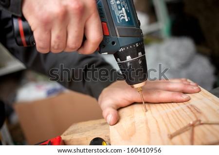 Man with screwdriver. Clouseup concept - stock photo