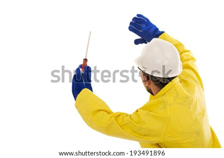 man with screwdriver in yellow rain protective suit - stock photo