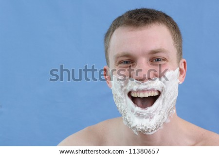 Man with shaving cream on - stock photo