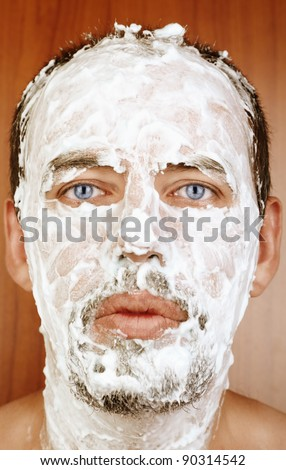 Man with shaving Cream on Face