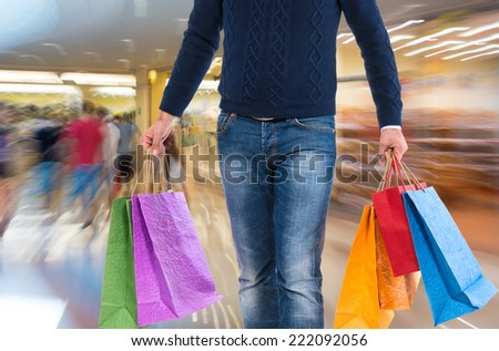 Man with shopping bags on a white background