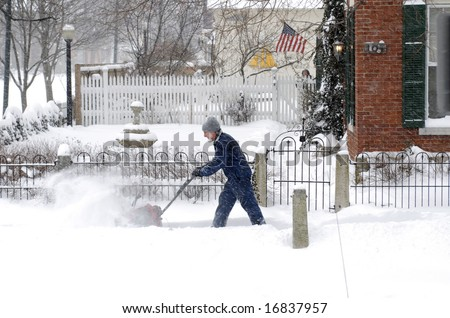 Man with Snow Blower - stock photo