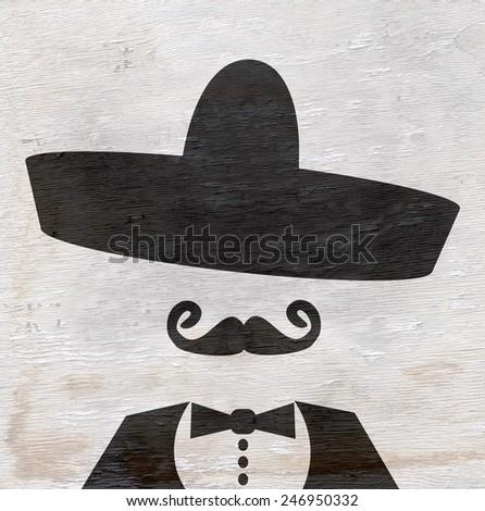 man with sombrero on wood grain texture  - stock photo