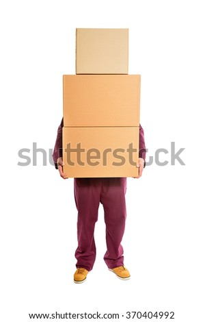 Man with stacked boxes isolated on white. - stock photo