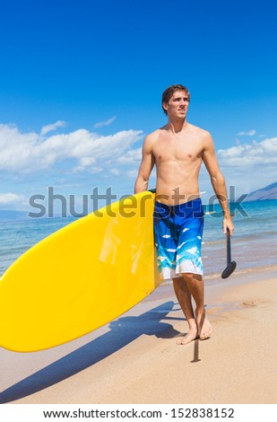 Man with Stand Up Paddle Board, SUP, on the beach in Hawaii - stock photo