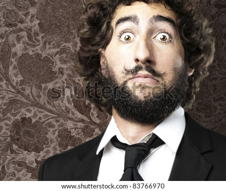 man with strange mustache against a vintage floral background
