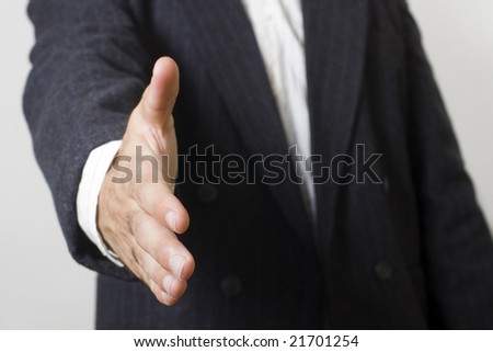 Man with suit asking to handshake