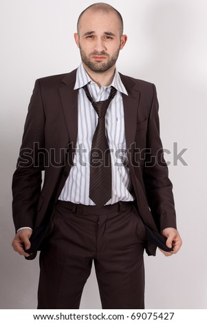 Man with suit is poor - stock photo