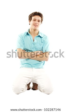 Man with summer beach style kneeling down while smiling