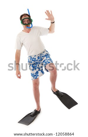 Man with swimming mask, snorkel and fins - stock photo