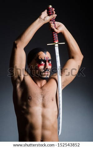 Man with sword and face paint