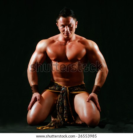 Man with the bared torso in a loincloth, on a black background