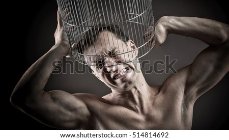 Man with the head inside a birdcage, concept