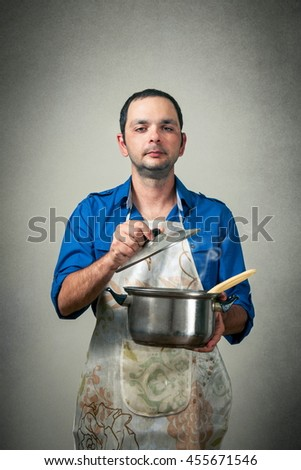 man with the meal in pan - stock photo