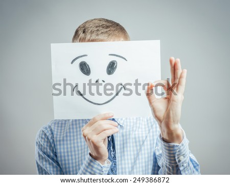 Man with the painted happy smile on the sheet of paper