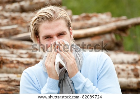 man with tissue - stock photo