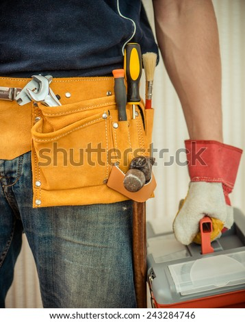 man with tools in leathern belt - stock photo