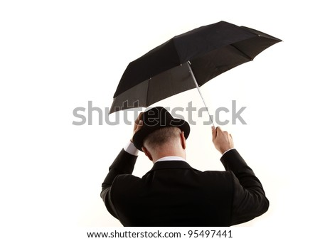 Man with umbrella on the wind - stock photo