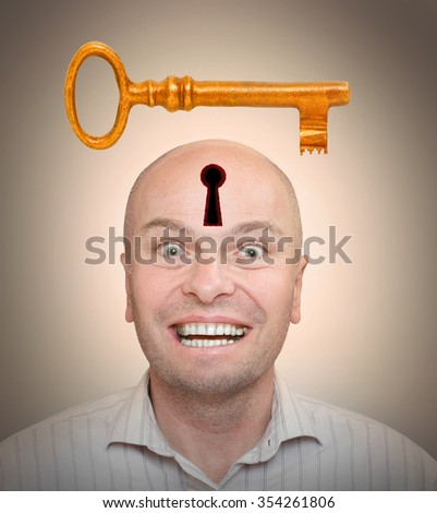 Man with unlocked head. New idea concept. Business or mental health metaphor. - stock photo