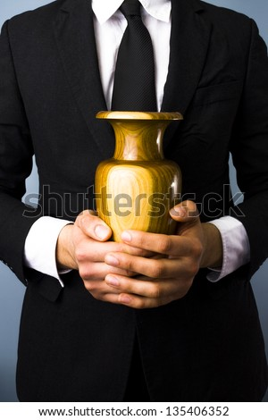 Man with urn - stock photo