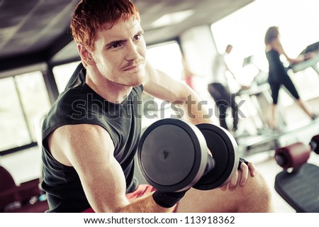 man with weight training equipment on sport gym club,Italy - stock photo
