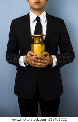 Man with wooden urn - stock photo
