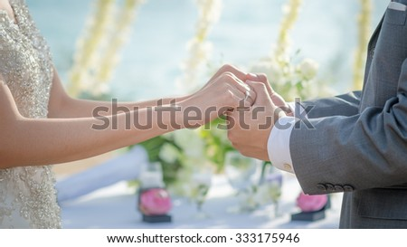 Man & Woman holding hands in wedding ceremony. Hand in hand. - stock photo