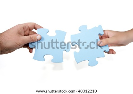 Man-woman joining puzzle concept isolated on white - stock photo