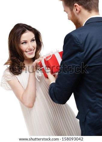 Man wonders his girlfriend with International Woman's Day present, isolated on white - stock photo