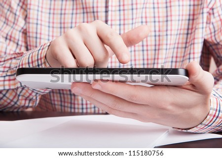 Man work with digital tablet and document - stock photo