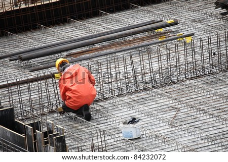 man, worker in construction building - stock photo