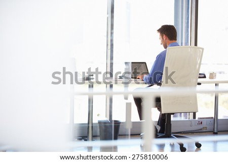 Man working alone in a modern office - stock photo