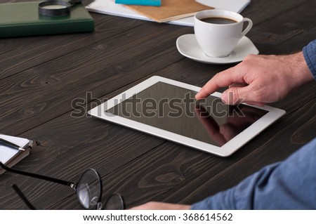 man working at home using tablet computer. Copy space