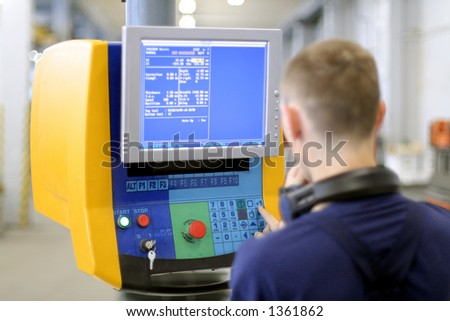 Man working at programmable machine. Sheet metal bending. Focus on monitor - stock photo