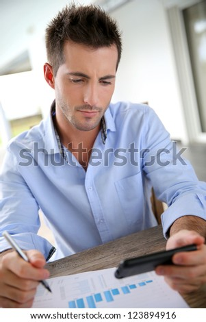 Man working from home on smartphone - stock photo
