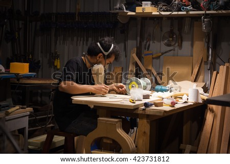Man working in workshop/tool room/carpentry tool store/hand tool using/small business /handmade work - stock photo