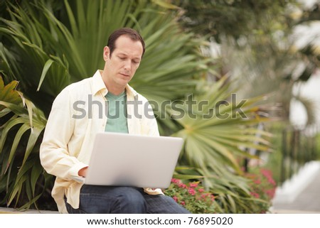 Man working on his notebook computer - stock photo