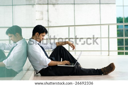 Man working on laptop - stock photo