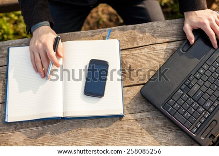 Man Working on Notebook and Writing Notes. - stock photo