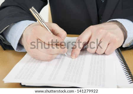 Man Working on Numbers - stock photo