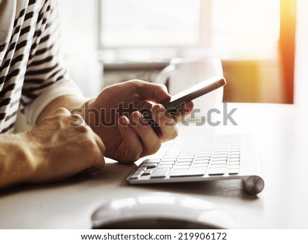 Man working on phone - stock photo