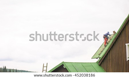 Man Working on the Roof, Sandering Paint