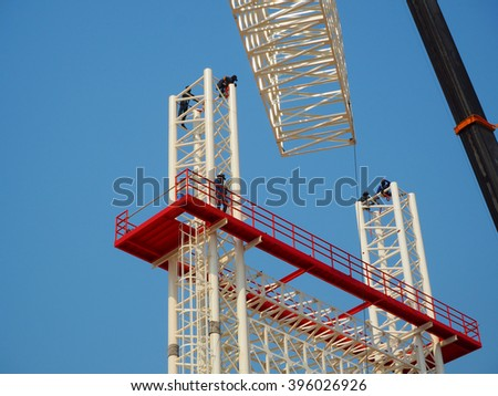 Man Working on the Working at height,sign board - stock photo