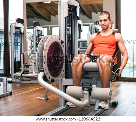 Man working out in a gym - stock photo