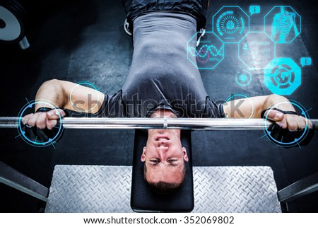 Man working out in gym against fitness interface - stock photo