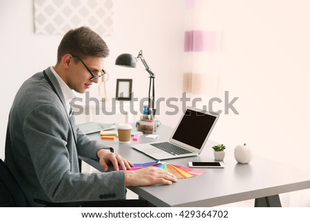 Man working with color samples at office - stock photo