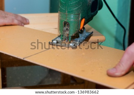 Man working with jig saw - stock photo