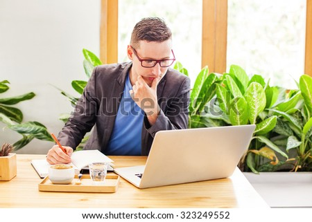 man working with laptop and thinking - stock photo