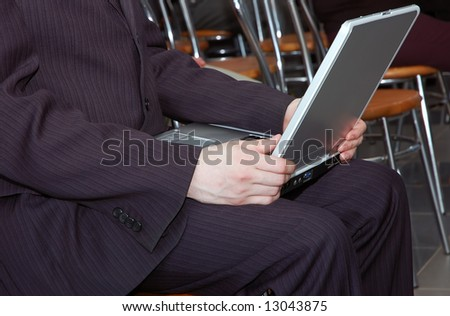 man working with portable computer as universal concept for many application - stock photo